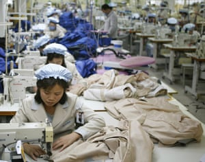 North Korean workers assemble jackets at a factory in the jointly-run Kaesong industrial complex.