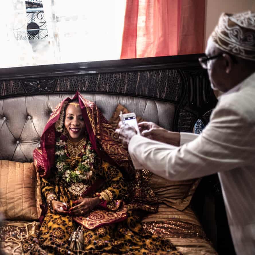 Badaant el Mounyrou, wearing full wedding attire, waits in the marital bedroom for the arrival of the groom