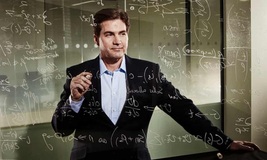 A publicity photo of Craig Wright writing equations on glass for some reason.