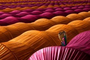 A strawberry-picker walks between colourful greenhouses near Nazilli, in the Aydın province of Turkey.