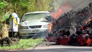 Lava engulfs a Ford Mustang in Puna
