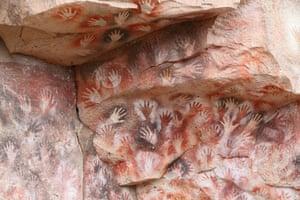 Cave hand paintings, dated to around 550 BC. Cueva de los Manos, Argentina.