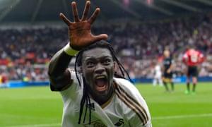 Bafétimbi Gomis celebrates after scoring Swansea's decisive second goal.