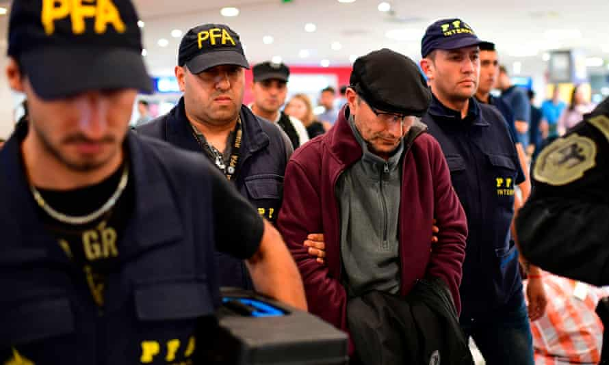 Mario Sandoval arrives in Buenos Aires after France extradited him to face charges over the disappearance of a student in 1976.