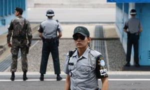 South Korean soldiers stand guard at the border village of Panmunjom between South and North Korea at the Demilitarized Zone (DMZ) on 12 July, 2017