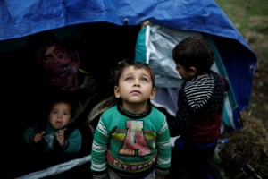 A young Syrian refugee boy at a makeshift camp on Lesbos
