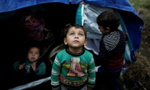 Syrian children in front of their tent next to the Moria camp.