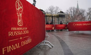 Russian policemen at the Kremlin in Moscow stand next to banners with the logo of the Fifa World Cup 2018 final draw.