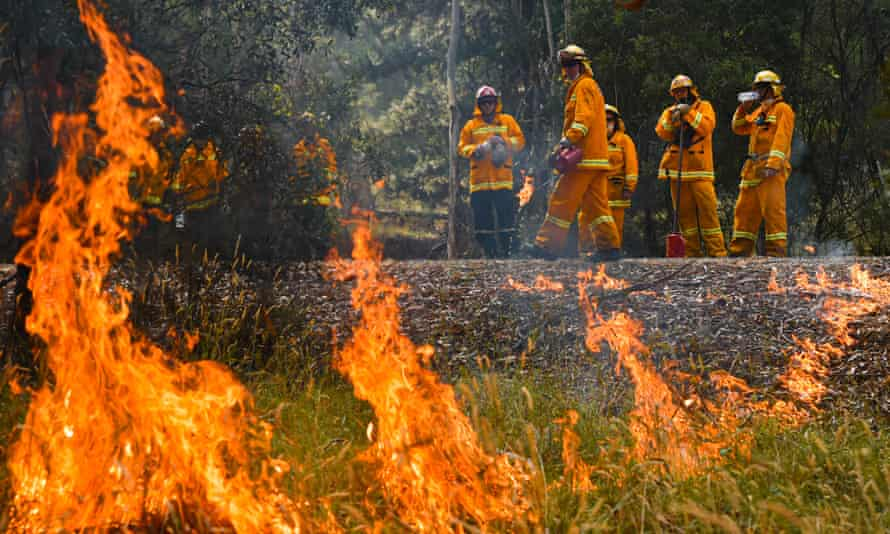 Country Fire Authority strike teams performing controlled burning west of Corryong, Victoria. The Corryong fire has begun to merge with a bushfire in the NSW southern highlands