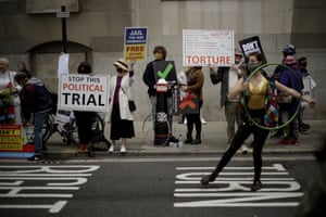 Supporters of WikiLeaks founder Julian Assange take part in a protest outside the Old Bailey in London.