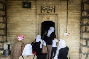 Women celebrating their return from Isis captivity in a new ritual at a shrine in Lalish, northern Iraq.