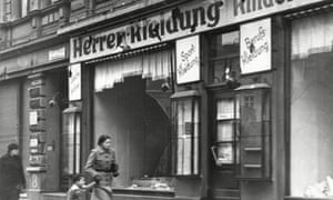 A mother and child passing by smashed shop windows after Kristallnacht in Magdeburg, in November 1938.