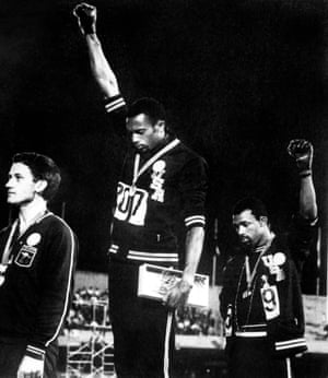 Tommie Smith (centre) and John Carlos (right) doing the black power salute at the 1968 Olympics