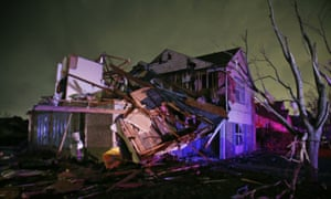 Debris lies on the ground near a home that was heavily damaged by a tornado in Rowlett, Texas.