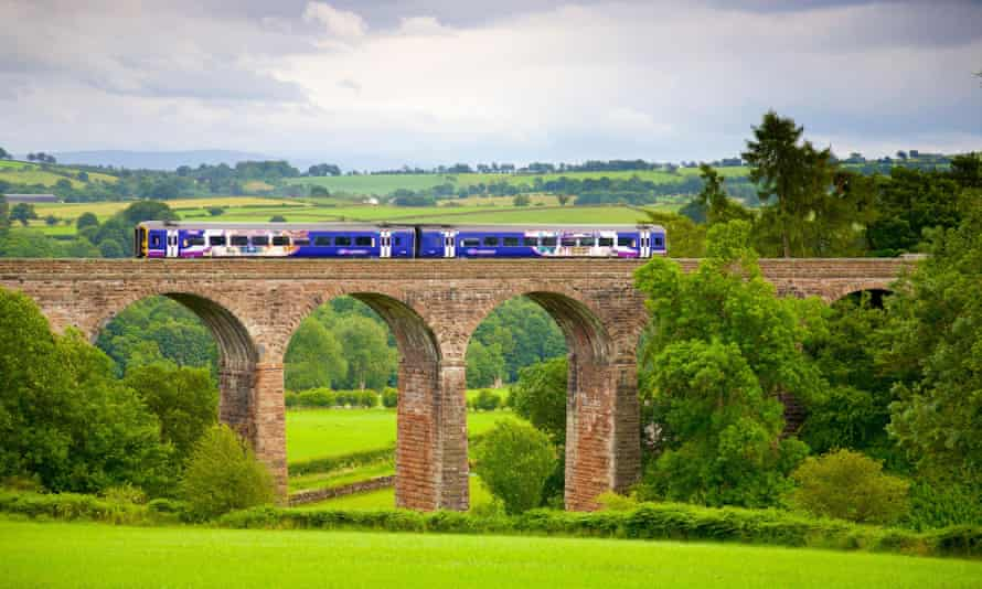 The Settle to Carlisle Railway Line. Sprinter passenger diesel train passing over Dry Beck Viaduct, Eden Valley, Cumbria, England.