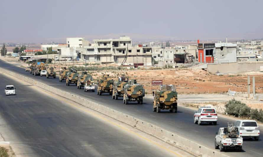 Turkish forces in a convoy on a main highway in Idlib province.