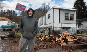 Donald Trump supporter Ricky Farnsworth stands for a portrait outside of his trailer in Buckhannon.