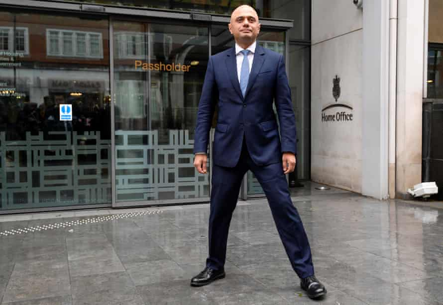 Sajid Javid stands outside the Home Office after being named home secretary. With his legs really wide apart.