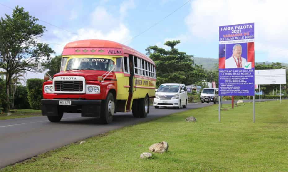 Traffic passes an election billboard