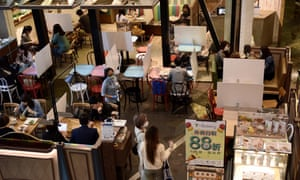 Makeshift partitions separate tables at a restaurant in Hong Kong to stem the spread of Covid-19.