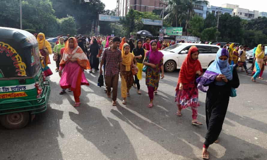 Garment workers on their way to work in Dhaka, Bangladesh. Of workers surveyed by Oxfarm in Bangladesh, 100% said they could not make ends meet.