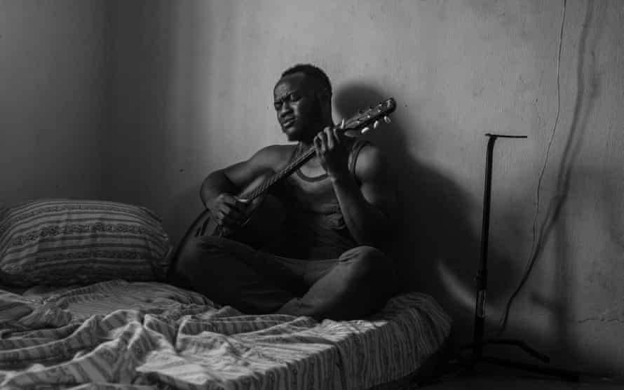 Eyitayo playing guitar in his room. July 14, 2020. Ilorin, Nigeria.