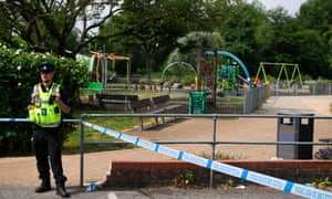 A police officer stands at a cordon by a park at Queen Elizabeth Gardens in Salisbury.
