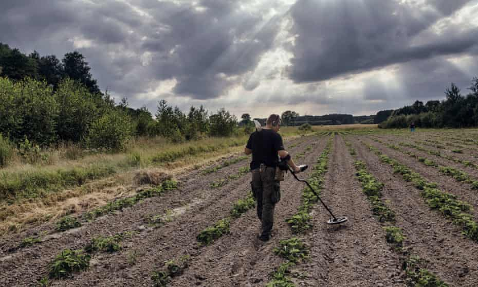 'When I am digging, I am escaping': Piotr scours a field for buried treasure of the wars past.