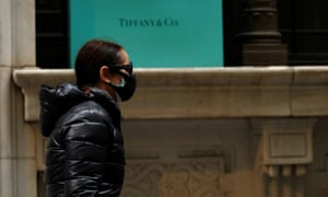 A man passes by the closed Tiffany & Co store on Wall St. in the financial district of New York City