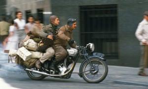 """Film Title: The Motorcycle Diaries<br>Pictured: Ernesto Guevara (Gael Garc a Bernal) and Alberto Granado (Rodrigo de la Serna) ride through the streets on their Norton 500 as they leave Buenos Aires.dir Walter Salles"""