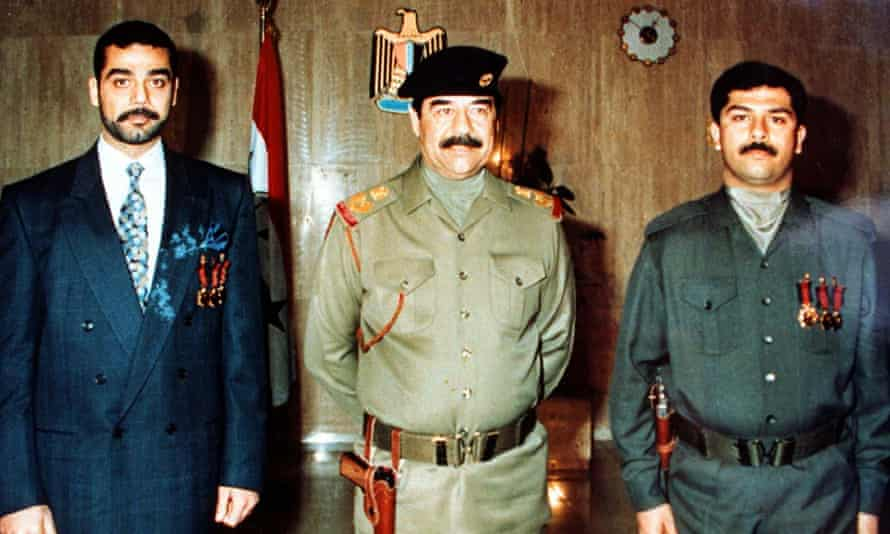 Saddam Hussein with his sons Uday (left) and Qusay.