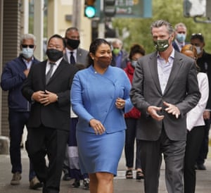 California governor Gavin Newsom with San Francisco Mayor London Breed walking to a news conference.