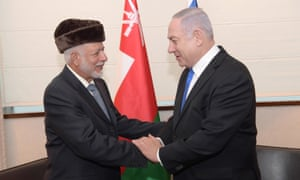 Netanyahu (right) shakes hands with Omani foreign minister Yusuf bin Alawi bin Abdullah (L) prior to their meeting in Warsaw.