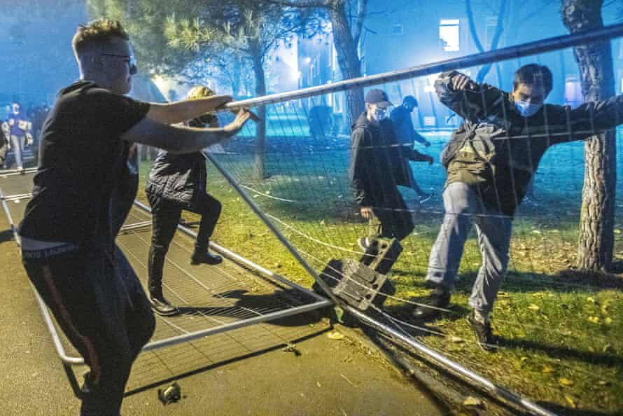 On the first day of the second lockdown, 5 November 2020, Manchester students tear down fences erected by the university around their accommodation block.