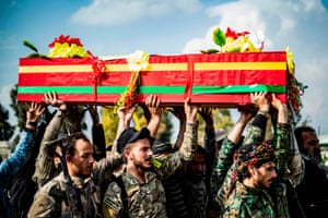 Qamishli, SyriaMembers of the Kurdish-led Syrian Democratic Forces (SDF) carry the coffin of a fighter who was killed Deir Ezzor province.