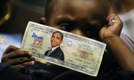 child holds fake bill with obama on it
