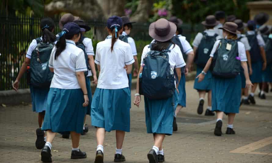 teens in school uniform walking to school