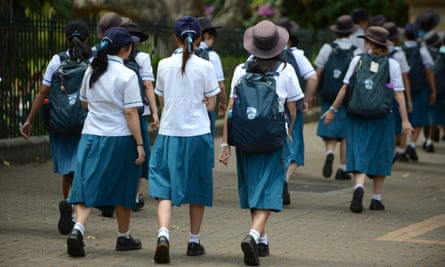 A group of high school students walk together during a school excursion in Brisbane