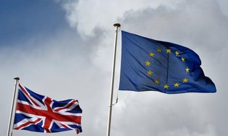 The European Union flag flutters next to the EU flag.
