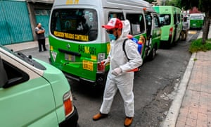 MEXICO-HEALTH-VIRUSA cleaning worker wearing personal protective equipment (PPE) disinfects a public transport vans in Mexico City.