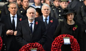 Jeremy Corbyn stands next to Theresa May, with former prime ministers Tony Blair (left) and Sir John Major, standing behind them