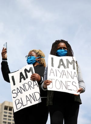 Two protesters are seen outside of the Detroit Public Safety Headquarters building for a protest against the death in Minneapolis police custody of African-American man George Floyd and the assault of Sha'Teina and Dan Grady El by Washtenaw County police, in Detroit, Michigan, U.S. May 29, 2020.