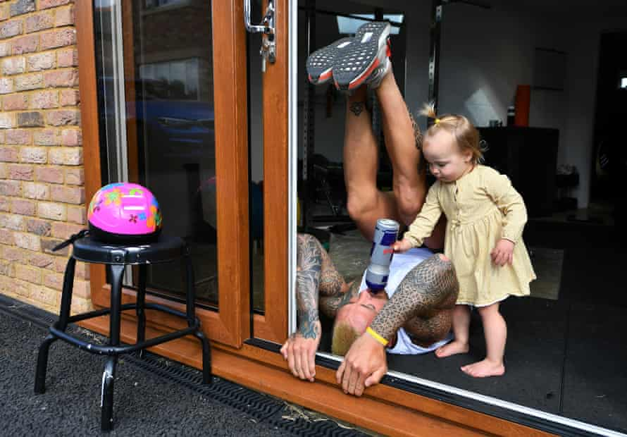 Jack Nowell of Exeter  and England receives a drink from his daughter Nori while he exercises at home during the coronavirus lockdown on 13 May.