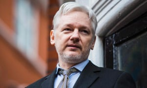 Julian Assange addressing the media from the balcony of the Ecuadorian embassy in central London.