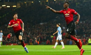 Paul Pogba celebrates making it 2-0 against Huddersfield Town and he then got a second.