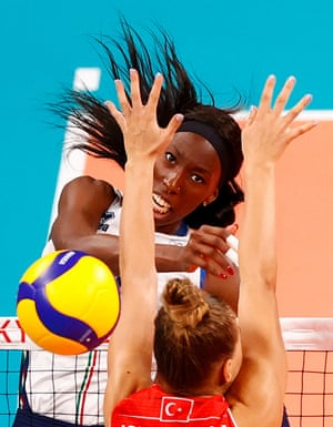 Paola Egonu smashes the ball past Turkey's Meliha Ismailoglu during Italy's 3-1 victory in their volleyball pool game.