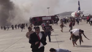 People run after explosions hit Aden airport shortly after a plane carrying the newly formed cabinet landed.