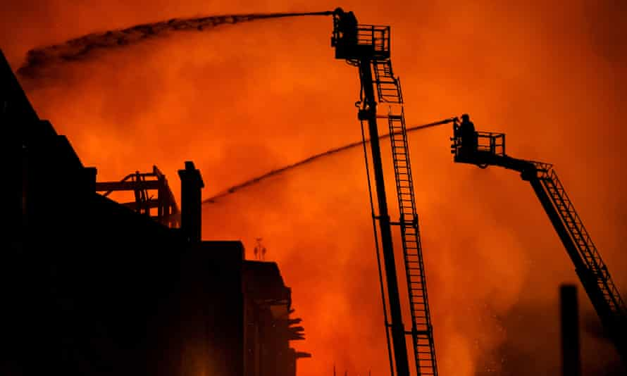 Firefighters tackle the blaze at its height on Friday night.