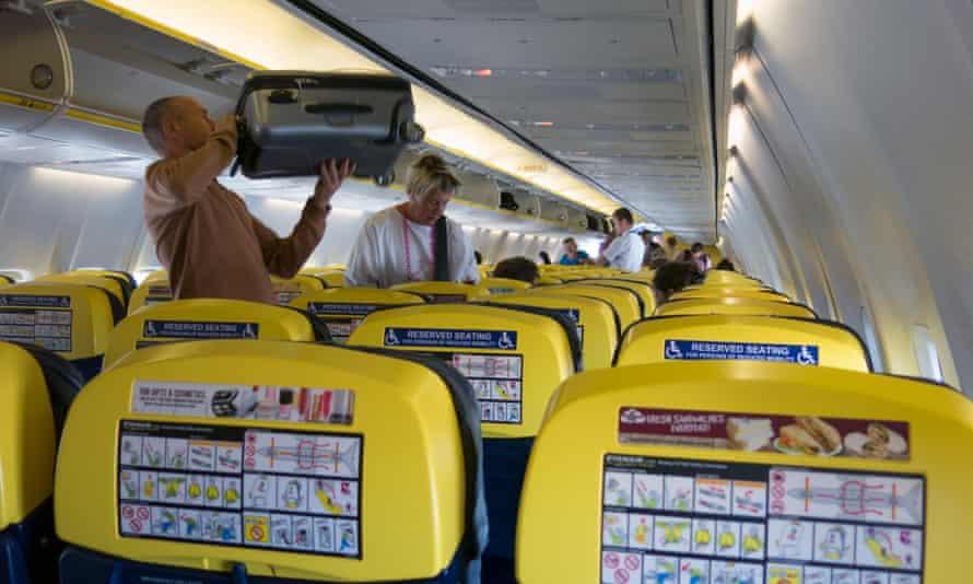 a passenger puts a bag into a locker