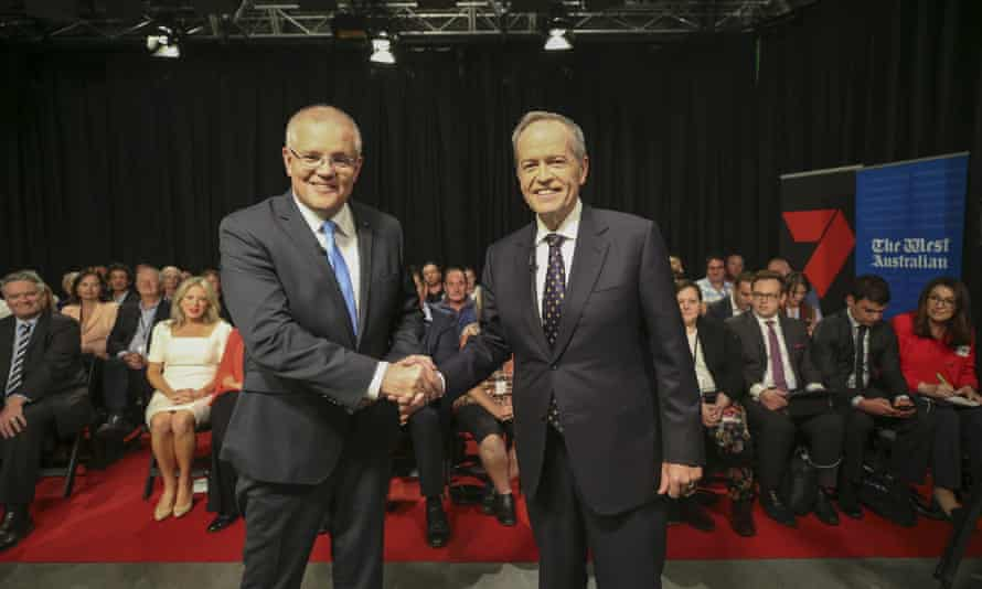 Scott Morrison and Bill Shorten shake hands before the first televised leaders debate in Perth.